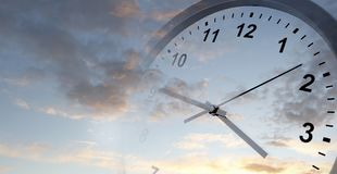 Clock in sky. Clock face in sky. Time passing Royalty Free Stock Photo