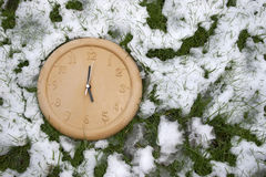 A clock face in the snow Royalty Free Stock Image