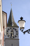 Clock face and street lamp. Ornate clock face in Zurich Switzerland royalty free stock photo