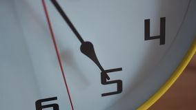 Clock face with ticking second hand. Close up shot. Clock face with ticking second hand. Big yellow home clock on table. Close up shot stock video