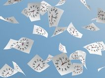 Clock face. White papers with clock face flying on sky Royalty Free Stock Image