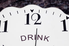 Clock face with word drink Royalty Free Stock Photos