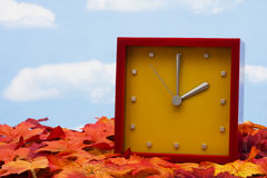 Clock on Fall Leaves Royalty Free Stock Images