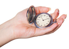 Clock in a female hand Royalty Free Stock Photo
