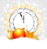 Clock and festive decorations on to snow Stock Photography