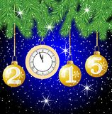 Clock and festive marbles with numbers 2015 hang on the branches Royalty Free Stock Image