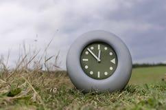 Clock In A Field Stock Photo