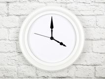 Clock without figures hanging on a brick wall stock photos