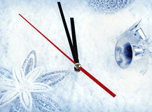 Clock with fir branches and Christmas decorations under snow clo Stock Photography