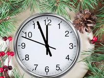 Clock on snow under decorated christmas tree royalty free stock photos