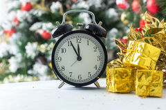 The clock at five minutes to twelve Stock Image