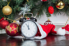 The clock at five minutes to twelve Royalty Free Stock Photography