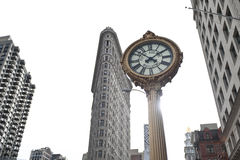 Clock by flat iron Building. A shot of a antique clock by the flat iron building in New York City Royalty Free Stock Photo
