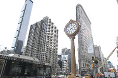 Clock by flat iron Building Royalty Free Stock Photos