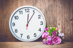 Clock and flower Stock Image