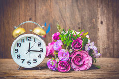 Clock and flower Royalty Free Stock Photography