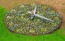 Clock of flowers. In garden Stock Photo