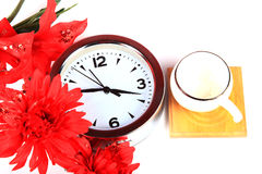 Clock and flowers Stock Photo
