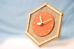 Clock flying through the sky. A picture of a hexagonal hand-made clock, flying through the sky stock image