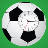 Clock in football ball. On green background with stripes Royalty Free Stock Photos