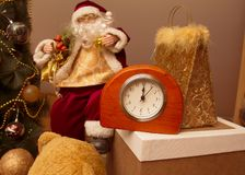Santa`s Toy and clock. 2019 Happy New Year. The clock is in the foreground. Behind the clock is Santa`s Toy stock images