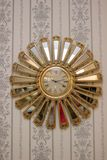 Clock in a form of sun on a wall. Clock in a form of sun on a wall Royalty Free Stock Photos