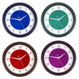 Clock in four colors Royalty Free Stock Images
