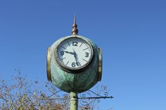 Clock four sided town square Stock Photos