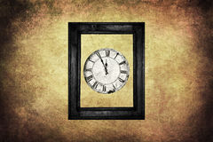 Clock in frame Stock Photography