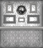 Clock and frames hanging on the wall Royalty Free Stock Photo
