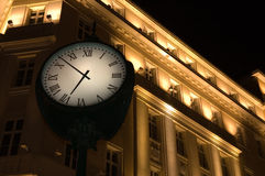 Clock in front of the hotel Royalty Free Stock Photo