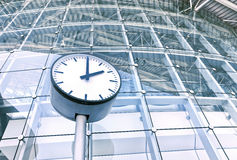 Clock in front of an office building Royalty Free Stock Image