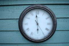 Frozen clock. A clock frozen in time on a frosty morning royalty free stock photography