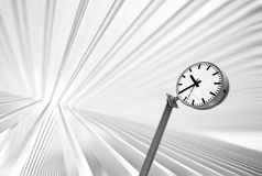 Clock in futuristic interior with blurred backgrou Stock Image