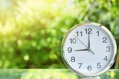 Clock in garden stock photos