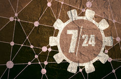 Clock in gear and symbols 7, 24 Stock Image