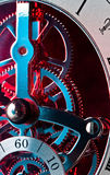 Clock Gears. Dynamic close up of a steampunk style metal Clock showing mostly just the gears and lit with red and blue lights Royalty Free Stock Photo