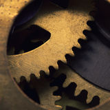 Clock gears. Closeup of gears inside old clock mechanism stock photo