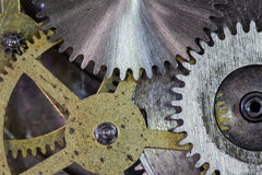Clock gears and cogs macro background Stock Photo