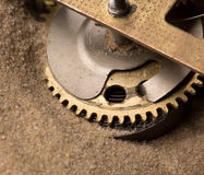 Clock gears in sand Royalty Free Stock Photo