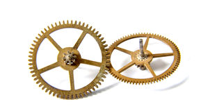 Clock gears on a white background. Picture of an Old Clock gears on a white background Stock Photo