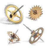 Clock Gearwheels. Clock cogs individually photographed isolated on white background. Shallow D.O.F Royalty Free Stock Images