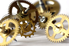 Clock gearwheels. Dismantled clock mechanism, gearwheels; differential focus Stock Photography