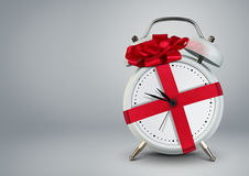 Clock in gift ribbon on grey, time to gift cocept, copy space. Clock in gift ribbon, time to gift cocept, copy space stock photography