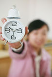 Clock with girl in class room Royalty Free Stock Photo
