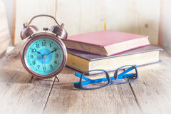 Clock and glasses Stock Images