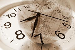 Clock and Globe Stock Images