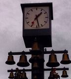 Clock and golden bells. A picture of a clock and golden bells in the towns center in London,The leicester square,in a summer day Royalty Free Stock Photography