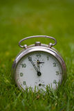 Clock on a grass Royalty Free Stock Image