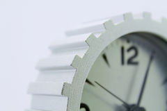 Clock. The Gray Gear Clock in white background Stock Image